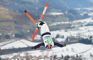 United States's Heidi Kloser jumps during the women's freestyle World Cup dual moguls skiing competition in Kreischberg, Austrian province of Styria, on Saturday, Dec. 22, 2012. Kloser placed second. (AP Photo/Kerstin Joensson)