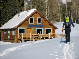 Skier arrives at Harry Gates Hut, part of the 10th Mountain Division Hut System.  Paragon Guides offers trips Hut trips throughout the 10th Mountain Division Hut System