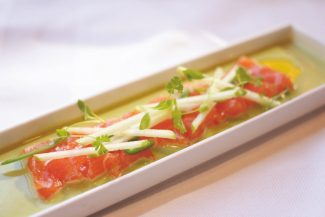 """At Leonora Restaurant in The Sebastian in Vail, Executive Chef Sergio Howland uses Skuna Bay salmon in this salmon crudo with green curry, slivered apple, serrano and coconut """"leche de tigre."""""""