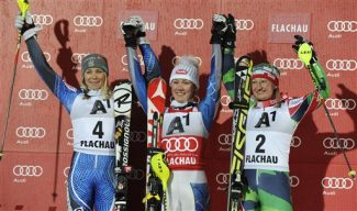 From left, Sweden's Frida Hansdotter, second placed, the winner Mikaela Shiffrin, of the United States, and  Finland's Tanja Poutiainen,  third placed, celebrate on podium after an alpine ski, women's World Cup slalom, in Flachau, Austria, Tuesday, Jan. 15, 2013. (AP Photo/Giovanni Auletta)