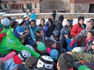 Special to the Daily This year, more than 2,700 kids will hit the slopes with SOS Outreach, which helps at-risk youth excel in the classroom and learn life skills on the mountain