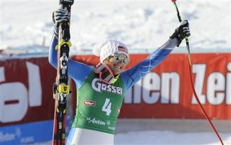Alice McKennis, from the United States, celebrates after crossing the finish line to win an alpine ski, women's World Cup downhill in St. Anton, Austria, Saturday, Jan.12, 2013. (AP Photo/Giovanni Auletta)
