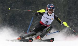 United States' Mikaela Shiffrin clears a gate during the second run of the women's slalom, at the Alpine skiing world championships in Schladming, Austria, Saturday, Feb.16, 2013. American teenager Mikaela Shiffrin became the youngest women's slalom world champion in 39 years on Saturday. (AP Photo/Luca Bruno)