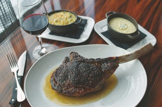 Special to the DailyAt Larkspur Restaurant in Vail, Executive Chef Richard Hinojosa serves Creekstone Farm's 41-ounce Tomahawk Ribeye with potato puree, organic broccoli chappleur, tarragon hollandaise and sauce Diane. For those with a less voracious appetite he also serves a more modest Creekstone Farm New York Strip.