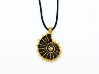 Special to the DailyThis is one of Carolyn Tyler's long cord pendants, made from a fossil ammonite and a champagne diamond.