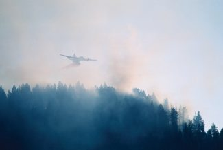Fire plane dropping water on forest fire, Sun Valley, Idaho, USA