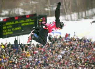 Olympic gold medalist Kelly Clark soars above the crowd to win the Women's U.S. Open Snowboard Halfpipe championships, Saturday, March 16, 2002, at Stratton Mountain Ski area in Stratton, Vt. (AP Photo/Jim Cole)