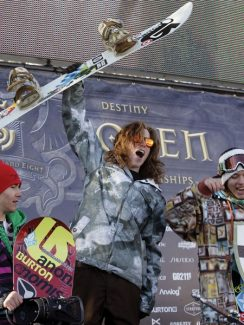 ** FILE ** In this March 21, 2008, file photo, Shaun White, center, celebrates his win in the Men's Slope Style competition at the 26th Annual U.S. Open Snowboarding Championships, at Stratton Mountain Resort in Stratton, Vt. Olympic champions Shaun White and Kelly Clark will headline the 27th annual U.S. Open Snowboarding Championships this weekend at Stratton Mountain, Vt. The event, considered the granddaddy of snowboarding championships, draws about 40,000 people. (AP Photo/Alden Pellett, File)