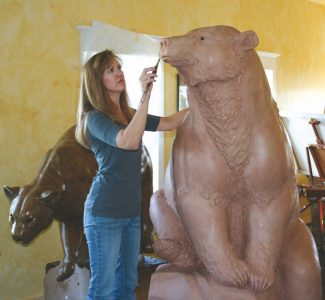 Special to the DailyBronze artist Melissa Cooper works on one of her large sculptures.