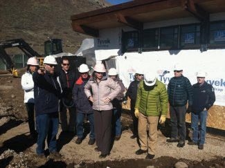 Lauren Glendenning | lglendenning@vaildaily.comTodd Oppenheimer shows Vail town council members and other town officials the progress on the concession stand and other buildings currently under construction at Ford Park.
