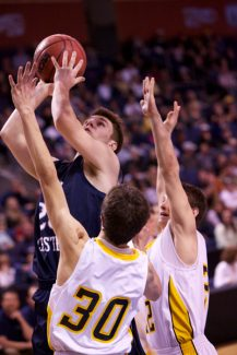 Brian Maloney, notesonmemories@gmail.com | SpecialVail Christian's Gunnar Wilson goes up for his two of 32 points Saturday during the third-place game of 1A state tournament at the 1stBank Center in Broomfield. The Saints beat Caliche, 87-76, to finish third at the tournament.