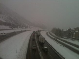 Eastbound vehicles are directed off I-70 at the main Vail exit Thursday.
