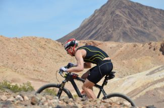 Special to the DailyJosiah Middaugh powers through the cycling leg of the Xterra West Championship at Lake Las Vegas in Henderson, Nev., on Saturday. Middaugh captured the opening triathlon of the season.