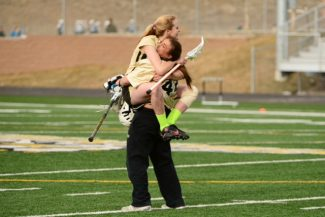 Special to the DailyBattle Mountain lacrosse's Clare Baker, left, celebrates with goalie Siena Miller earlier in the season. Huskies girls lacrosse won its first game against Summit County Thursday.