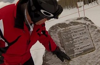 Bob Ruder, son of the late Leonard Ruder, dusts off a plaque honoring his father Saturday, Feb. 9, 2013 in Vail. Leonard Ruder would have turned 93 today.
