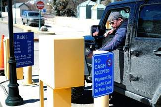 A visiter pays for parking at the Village Parking Structure in Vail on Wednesday. Skier visits at Colorado resorts grew 11.9 percent, Vail Resorts said Wednesday.