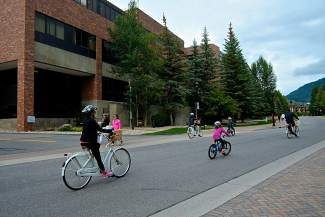 A family of tourists spreads across West Meadow Drive on their bicycles in front of the Vail Valley Medical Center on Tuesday. The medical center is looking at a plan for the future of its layout, including eliminating hospital traffic from West Meadow Drive—a road often clogged with pedestrians and vehicles.
