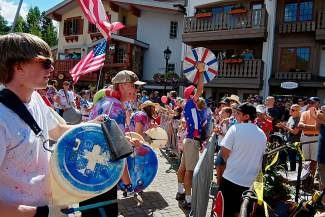 Members of Trinity Church get up close with the crowd while drumming during the Vail America Days parade on Friday.