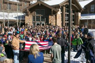 Vail Mountain School students stand in respect as the folding of the school flag is led by Seth Molina, of Vail. Another flag was raised for the day in honor of veteran and former VMS student Randy Gonzales.