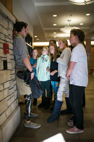 U.S. Marine Corps veteran Daniel Riley answers questions from Vail Mountain School students after a Veterans Day presentation in the school's theater in Vail on Tuesday. Daniel spoke to the students about his experiences in the military, including the loss of both of his legs.