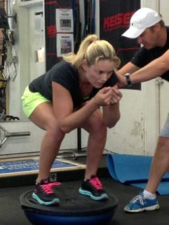 Lindsey Vonn works out in 2013 at Ski and Snowboard Club Vail with her trainer, Martin Hager, of Red Bull.
