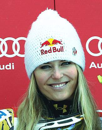 Lindsey Vonn, center, greets the crowd while backed by the women's U.S. Ski Team Alpine Team in 2011 in Vail Village.