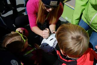 Lindsey Vonn signs the helmet of a young fan while another lifts her EpicMix glasses for a better view of the celebrity at Beaver Creek in 2014.