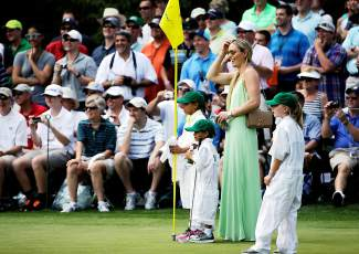 Lindsey Vonn watches Tiger Woods with his children Sam and Charlie during the Par 3 contest at the Masters golf tournament Wednesday, April 8, 2015, in Augusta, Ga. (AP Photo/David J. Phillip)