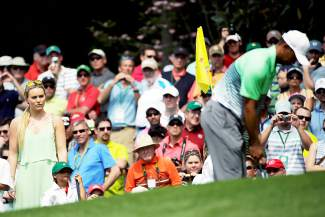 Lindsey Vonn watches Tiger Woods with his children Sam and Charlie during the Par 3 contest at the Masters golf tournament Wednesday, April 8, 2015, in Augusta, Ga. (AP Photo/Matt Slocum)