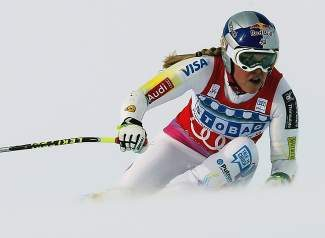 Lindsey Vonn speeds down the course on her way to win a women's World Cup super-G, in St. Moritz, Switzerland in 2012. The Olympic downhill champ planned to start this season after knee surgery earlier this year. A training crash on Copper Mountain on Tuesday may put those plans in jeopardy.