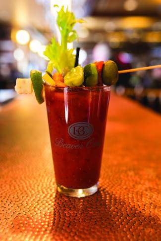 Broken Arrow's bloody mary comes with a skewer with nine items on it. Consider it cocktail and a snack all in one.