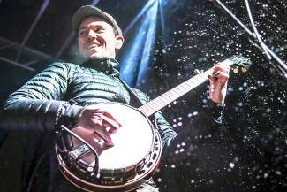 Chris Pandolfi from The Infamous Stringdusters picks his banjo through the snowfall of last year's WinterWonderGrass Festival.