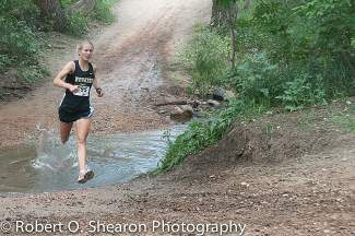 Battle Mountain's Val Constien plows though the water on her way to a third-place finish in the Cheyenne Mountain Stampede Thursday in Colorado Springs.