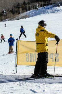 Beaver Creek Mountain Safety employee Ethan Gilman keeps an eye out for out-of-control skiers who funnel down into the beginner area towards the bottom of the hill Friday in Beaver Creek.