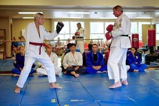 David Stern, left, stares defiantly at his master Matthew Bayley in front of a row of judges while testing for his black belt in Vail. Seventy-year-old Stern, with one arm and a second-hand liver, managed in the end to earn his black belt—one of only 15 that Bayley has awarded in his 36 years of martial arts instruction.