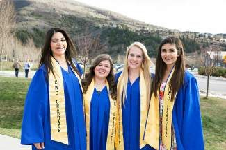 Four local high school graduating seniors also donned caps and gowns for Colorado Mountain College's commencement. The students all earned Associate of Arts degrees from CMC as they graduate high school, because of their work with dual enrollment classes. They are, from left, Battle Mountain's Maria Villarreal, and Eagle Valley's Reagen Gass, Tiffany Sheehy and Marisol Chacon.