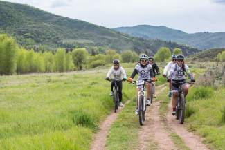 The Cycle Effect team rides together in the Miller Ranch open space on May 30. Team members are required to complete 25 hours of community service per year, teaching them the value of giving back and partnering with other nonprofit agencies in their community.