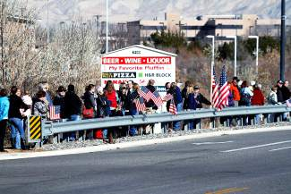 People line Horizon Drive in Grand Junction on Thursday awaitng the  procession carrying the body of  Air Force Capt. Will DuBois to pass by.
