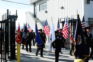 Grand Valley's honor guard enters the tarmac near West Star Aviation for the processional honoring Capt. William DuBois.
