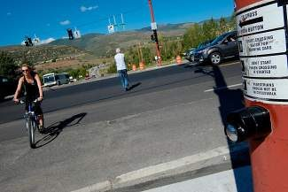 Pedestrians cross Highway 6 in Edwards at the intersection with Edwards Village Boulevard on Tuesday. To fund the study and design of a new roundabout at the intersection, Eagle County is putting up $250,000, the Edwards Community Authority is putting up $250,000 and the Colorado Department of Transportation is putting up $500,000.