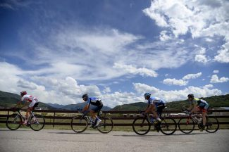 Riders cross Colorado Highway 82 during the USA Pro Challenge on Monday.