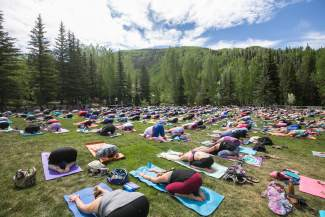 Hundreds of Mountain Game atendees enjoy The Yoga Girl Experience held in the Betty Ford Gardens Saturday.  The specific session was deemed, The Art of Letting Go.