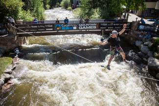 Keagan French highlines above Gore Creek during a demonstration at International Bridge in Vail  on Sunday.