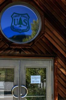 A sign was posted to the front door of a U.S. Department of Agriculture office explaining its closure due to the lapse in federal government funding Tuesday at the Holy Cross Ranger Station near Dowd Junction. The sign also mentioned the office will reopen once Congress restores funding.