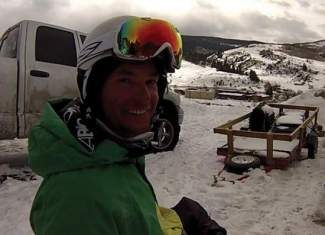 Injured Marine Daniel Riley smiles March 11 after completing the Minturn Mile on his monoski.