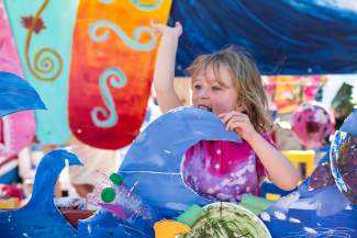 Ashlyn Kirkham, 4, waves to the crowds from the Vail Alpine Arts Center's float during the Vail America Days Fourth of July parade on Monday