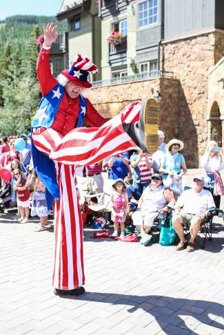 A patriotic leg kick from a stilted parade participant brings smiles to the 2016 Vail America Days Fourth of July parade on Monday.