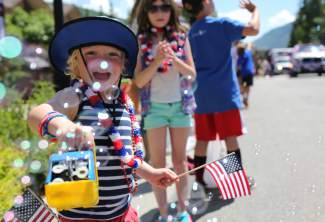 Gage Gros unleashes bubbles on West Meadow Drive during the Vail America Days parade Monday. This year's theme was the Spirit of America.