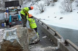 Colorado Department of Transportation crews drill into boulders freshly fallen from cliffs of Glenwood Canyon onto Interstate 70. The agency then used