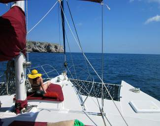 Shaye Troha of Los Angeles is seen sunning herself on the front of trimaran  sailboat on the way to the Marieta Islands.